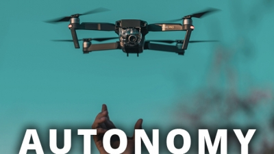 hand releasing drone with text AUTONOMY