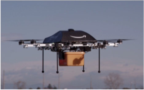 Figure 1: An Amazon.com drone delivering a package (Credit: Amazon.com)