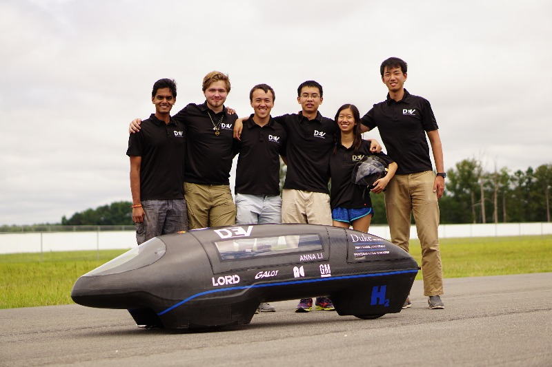 Dev team poses with Maxwell, the record-breaking vehicle