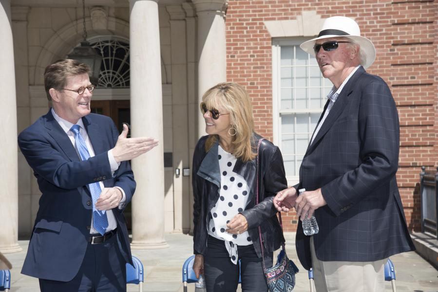 At the April 21, 2018 dedication ceremony, Duke President Vincent E. Price, left, recognizes Susan C. Harrington and Thomas E. Harrington E'66, for whom Harrington Engineering Quadrangle has been named.